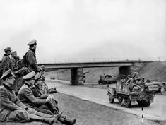 German officers sitting on the side of the road watching the US military using the Autobahn built by Hitler for his troops, April 1945. Germany Ww2, New Mods, German Army, World War Ii, Troops, Old Photos, Wwii, All About Time, The Past