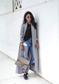 Sheryl Luke's grey duster coat looks cosy paired with distressed jeans and comfy sneakers. This is a great off-duty outfit and her Gucci bag adds a bit of designer glamour.  Top: TYLR, Coat: BNKR, Jeans: Shopbop, Bag: Gucci. Grey Coat Outfits