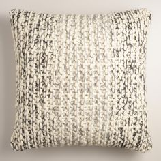 Our 100% wool throw pillow boasts a plush, chunky texture that's as warm and inviting as your favorite holiday sweater. Cozy up with this exclusive knit accent all winter long.