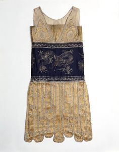 1925 dancing dress, Jeanne Paquin, embroidered and beaded silk with Chinese dragon design. Hits just below the knee. Victoria and Albert Museum