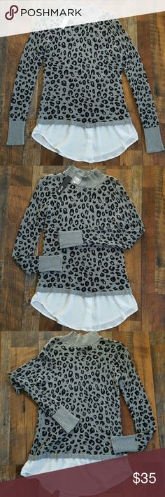 Womens sweater Cheetah print design sweater with attached shirt like detail in the bottom. Grey with black cheetah pattern. New with tags excellent condition. Apt. 9 Sweaters Crew & Scoop Necks