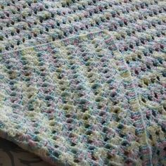 "$40. This beautiful blanket is hand crocheted by my mom. It is made out of Red Heart yarn in beautiful multi colors. Colors include pink, green, yellow, blue and white.   Blanket measurement is roughly 49"" x 51"".   Machine wash gentle cycle or hand wash. Lay flat to dry.   This blanket was made in a smoke free but very pet friendly home.   To purchase this item either leave email address below or check out my Etsy shop at https://www.etsy.com/shop/tinastreasures0309  #nopayments…"