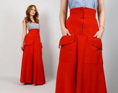 Vintage 70s red wide wale corduroy maxi skirt. Ultra high waist with pointed corset style waistband. Front zipper, full flared fit and oversized