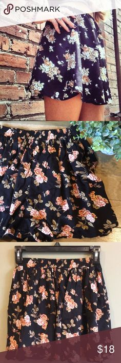BRANDY MELVILLE SKIRT Worn twice. Flowy, light weight, elastic waist. The neutral floral tone and black background works perfectly with so many colors and makes it an excellent statement piece. Says one size but I would call this xs/s. Brandy Melville Skirts Mini