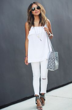 White top, white ripped jeans,  and black studded sandals