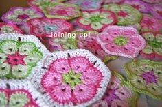 Resultado de imagem para flor africana de croche