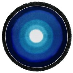 """Blue Lagoon Round Towel Inspired by """"Snells Window,"""" this towel portrays the feeling of total calm that comes from diving into the sea and looking back up towards the light of the sun as it breaks through the deep blue water."""