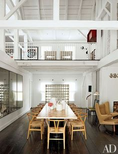 India Mahdavi designs a gorgeous country house in Connecticut. Pictured is the home's double-height dining room.