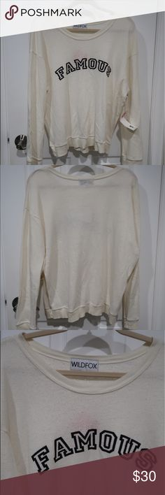 Wildfires oversized white/cream sweater Wildfires oversized white/cream sweater. Never worn. Tags still attached (not price tag tho) Wildfox Tops Sweatshirts & Hoodies