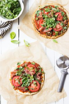 This Grilled Paleo Pizza recipe is sure to satisfy your summertime cravings, since this cauliflower crust is topped with fresh tomatoes, prosciutto and summer peppers!