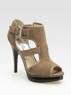 i love Michael Kors because he makes amazing shoes and bags but he also makes them affordable. Love these for fall!!!