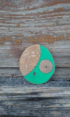 Wooden brooch drawn with pencil