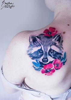 Sasha Marsh raccoon tattoo