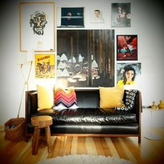 leather blacksofa with colourful pillows on it