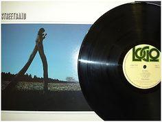 At £12.09  http://www.ebay.co.uk/itm/Street-Band-Dilemma-Stunning-Rare-Vinyl-LP-Logo-Records-1979-Near-Mint-Conditi-/261098546318
