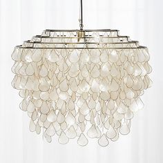 Grand in scale and statement, iridescent capiz shells seem to glow from within. Handcrafted by artisans in the Philippines where capiz is abundant, the shells are harvested from local windowpane oysters. Capiz Shell Chandelier, Brass Chandelier, Capiz, Small Pendant Lights, Capiz Chandelier, Chandelier Lighting, Modern Pendant Light, Contemporary Pendant Lights, Chandelier