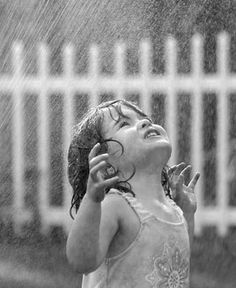 This was me as a little girl.  Always loved the rain.  (And, I still do!)