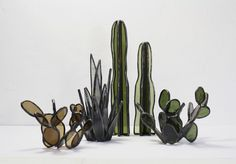 <p>Artist Lesley Green is stringly influenced by architecture and illustration. Working on stained glass and glass tile, she introduce modern design like these stained glass cacti and agave plants who