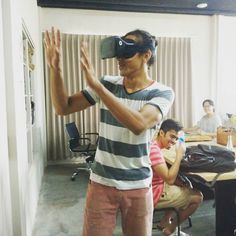 An awesome Virtual Reality pic! This morning Jordan was trying out a 3d-game made by Sam a virual reality developer here at kumpul. It was fun just to watch him  #kumpulco #skillsharing #coworking #exchange #coworkingspace #creativehub #rumahsanur #sanur #bali #virtualreality #vrdeveloper by kumpulco check us out: http://bit.ly/1KyLetq