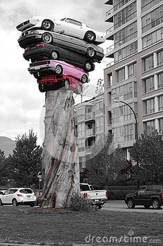 Modern pole with pile of cars in Vancouver