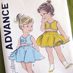 Adorable toddlers sunsuits. Midriff top,full and flouncy skirt with panties. Advance 9804; c. 1960s Size 1/2 T Breast: 19 Waist: 19 Size 1 T