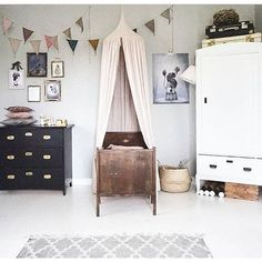 Kids room with antique bed and mix and match coloured furniture