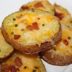 Cheesy Bacon Potato Rounds. Ingredients: 4 baking potatoes, cut into 1/2 inch slices; 1/4 cup melted butter; 8 slices bacon - cooked and crumbled; 8 ounces shredded Cheddar cheese; 1/2 cup chopped green onions. Directions: Preheat oven to 400 degrees F. Brush both side of potato slices with butter; place them on an ungreased cookie sheet. Bake for 30 to 40 minutes or until lightly browned on both sides, turning once. When potatoes are ready, top with bacon, cheese, and green onion; continue baking until the cheese has melted.