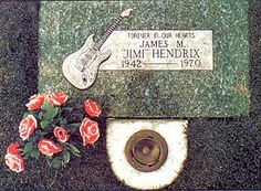 Jimi Hendrix - the original simple stone now embedded in the centerpiece of the monument later built by his father also on this board.