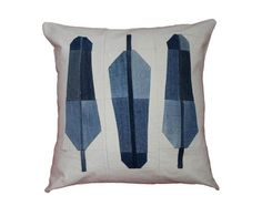 Modern quilt pillow in feathers design made with recycled denim and cotton natural canvas. Pillow is designed and hand-pieced by me in my Brooklyn