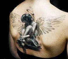 Big Wings Sad Angel Girl Tattoo On Upper Back