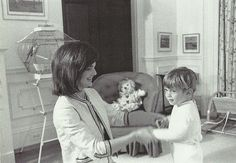 Jackie playing with her son John Jr. in his bedroom
