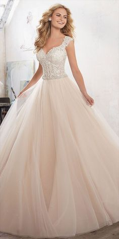 A Fairytale Princess Ballgown is Brought to Life with Crystal Beaded Embroidered Appliqués on Tulle Over Sparkle Net. The Diamant Waistband Adds a Perfect Touch of Glamour. Covered Buttons Accent Back. Matching Satin Bodice Lining Included.