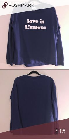 "Navy ""Love is L'amour"" Pullover Really cute pullover in great condition, only worn once! Size medium, soft, navy color with white fuzzy lettering. Feel free to make an offer or ask if you'd like to see it modeled by me (5'9 slim build) bundle multiple items for a discount! (See discount info post). Happy Poshing!😊 Old Navy Tops Sweatshirts & Hoodies"