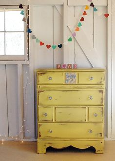 Adorable country antique dresser spotted at http://dotdot-dash.com/- love this color , soft yellow