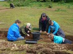 Children from Bishops Lydeard Primary School enjoying the test pit excavation at Cothelstone Hill, Somerset