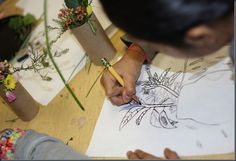 Drawing from nature.  Class went on a nature walk and then did line drawings of their flora and fauna.  Really great!!