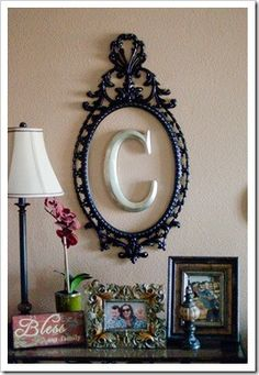 Simple cute idea......empty frame/mirror and initial.