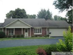 Convenient one level living on the golfcourse, beautiful front and back views, 3 season porch for private entertaining, hard wood floors, attached garage, end unit, Perfect lifestyle for the busy homeowner, all main level living, storage above garage.