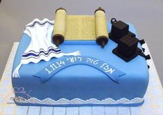 Bar Mitzvah cake in blue with Tefillin, Tallit and open Torah.