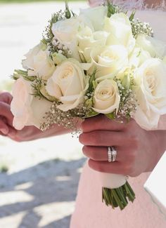 beautiful white roses with baby's breath bridal bouquet... via Trendy Wedding