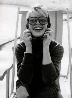 Turtleneck, headscarve and glasse with a big smile (Brigitte Bardot).