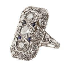 Art Deco platinum and diamond ring with trillion cut blue sapphire accent stones #estatejewelry #estatering