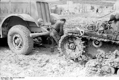 The Famo SdKfz 9 heavy 18 ton halftrack providing assistance to a stranded Italian light tank.