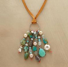 "A kinetic assemblage of turquoise, labradorite, aquamarine, blue chalcedony and cultured pearls dangling from supple deersuede. Handcrafted exclusive. Sliding bead adjusts length to 36""L."