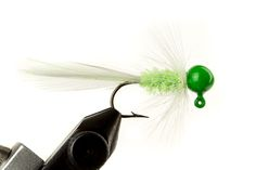 Glow Bugz Green & White Jig - Glow in the dark heads are great for ice fishing, deep water fishing, night fishing. The glow is the same color as the head paint, except white, which gives off that greenish glow. Tied with glow-in-the-dark custom chenille. Great for sunfish, bluegills, any panfish, crappies, walleye - they all love the subtle glow! Hand Tied by our friends at Haggerty Lures. Made in the USA! Please note size refers to the hook size and weight refers to the jig head weight.