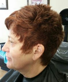 Haircut for over 50 with warm red tones.