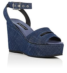 "Newbark Maggie Platform Wedge Sandals - Platforms - 504606376 | $425.00 | Newbark dark blue denim Maggie platform wedge sandals.       Handmade.     4.0""/100mm heel, 1.5""/40mm platform (approximately).     Open toe. Cutout at vamp. Crisscross buckled ankle strap.     Self-covered platform wedge.     Polished silvertone hardware.     Buckle closure."