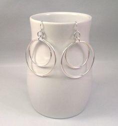 Silver double hoop earrings, very simple. $5 at http://www.etsy.com/shop/deafblindart