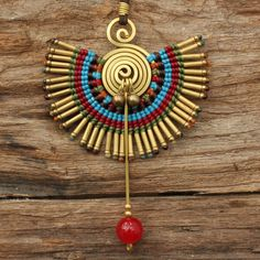 This is a stunning charm necklace that features a waxed cotton charm in multiple colors that has been mated to hand shaped brass. The charm also