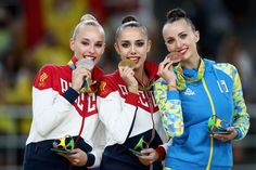 [L-R]  Silver medalist Yana Kudryavtseva of Russia, gold medalist Margarita Mamun of Russia and bronze medalist Ganna Rizatdinova of Ukraine celebrate on the podium during the Women's Individual All-Around Rhythmic Gymnastics Final on Day 15 of the Rio 2016 Olympic Games at the Rio Olympic Arena on August 20, 2016 in Rio de Janeiro, Brazil.